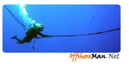Air diver at work at shallow depth