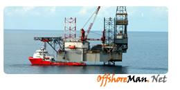Supply vessel alongside drilling rig